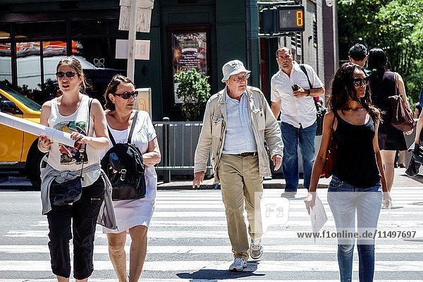 New York  New York City  NYC  Manhattan  Midtown  Turtle Bay  intersection  Second Avenue  Black  woman  man  senior  walking  crossing street  pedestrians