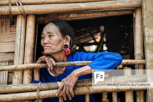 Rakhine state  Myanmar. Chin woman with traditional tattooed face.