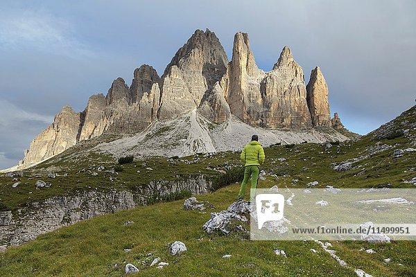Europe  Italy  Veneto  Belluno. An hiker looking the Tre Cime di Lavaredo south side  Dolomites.