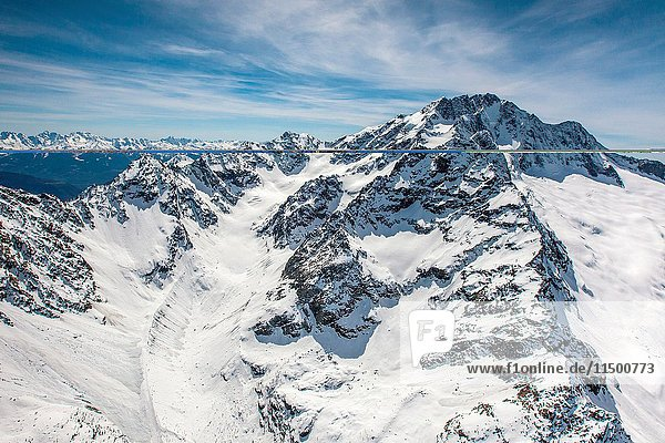 Aerial view of the pyramid of Mount Disgrazia in winter with the glacier of Ventina in close-up. Valmalenco  Valtellina .