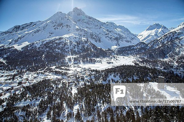 Aerial view of Belvedere tower with the houses of Maloja Pass covered in snow. Maloja Pass  Engadine  Canton of Grisons Switzerland Europe.
