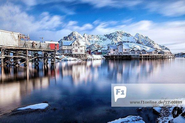 Clouds run over Henningsvaer fjord. Lofoten Islands. Norway. Europe.