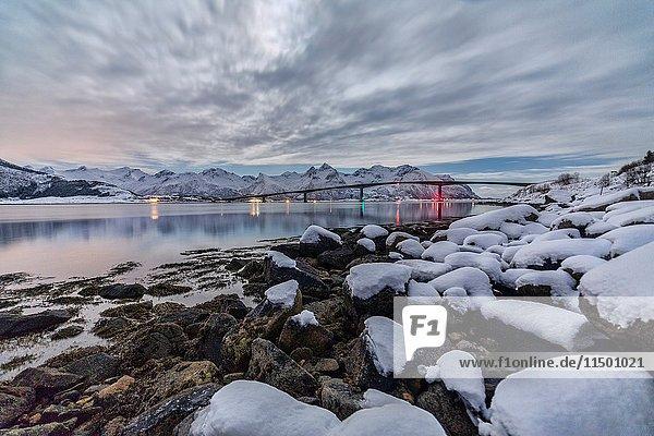 Cloudy sky over a bridge around Gymsøyand. Lofoten Islands Norway Europe.