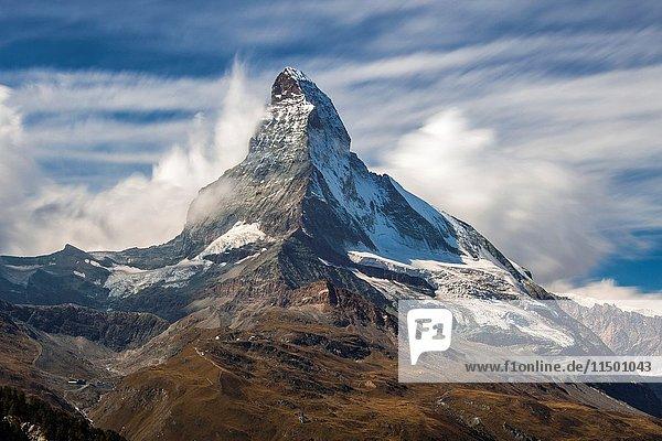 Matterhorn surrounded by clouds. Zermatt Canton of Valais Pennine Alps Switzerland Europe.