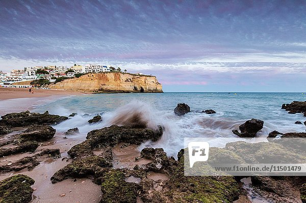 Sunset on the village of Carvoeiro surrounded by sandy beach and clear sea Lagoa Municipality Algarve Portugal Europe.