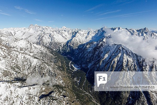 Aerial view of the snowy peaks in a sunny day of autumn Val Codera Chiavenna Valley Valtellina Lombardy Italy Europe.