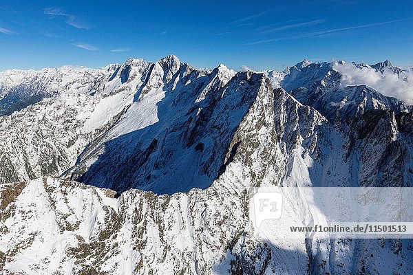 Aerial view of the snowy peaks and ridges in a sunny day of autumn Chiavenna Valley Valtellina Lombardy Italy Europe.