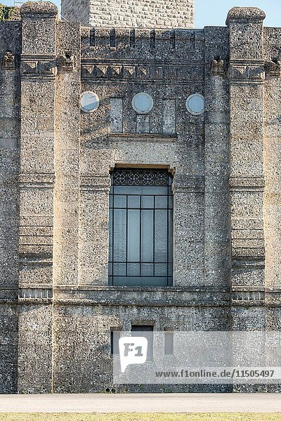 Detail of stone decorated facade at historical power house on Adda river at Trezzo  Lombardy   Italy.