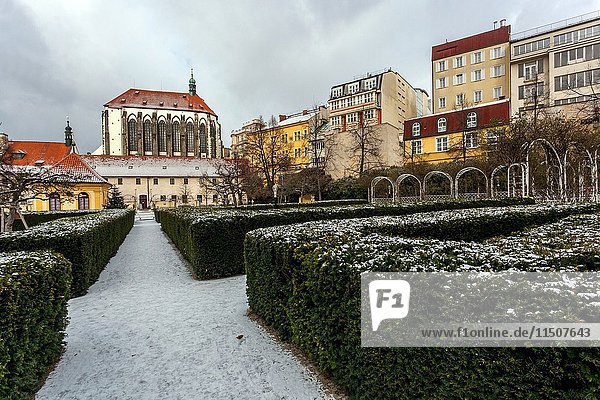 Quiet Franciscan Gardens near Wenceslas Square in the backgroundChurch of Our Lady of the Snows  Prague  Czech Republic.