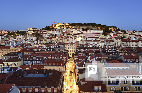 The historic centre (Baixa) and Sao Jorge castle at twilight. Lisbon  Portugal