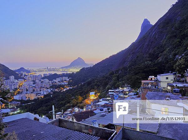Twilight view of the Favela Santa Marta with Corcovado and the Christ statue behind  Rio de Janeiro  Brazil  South America
