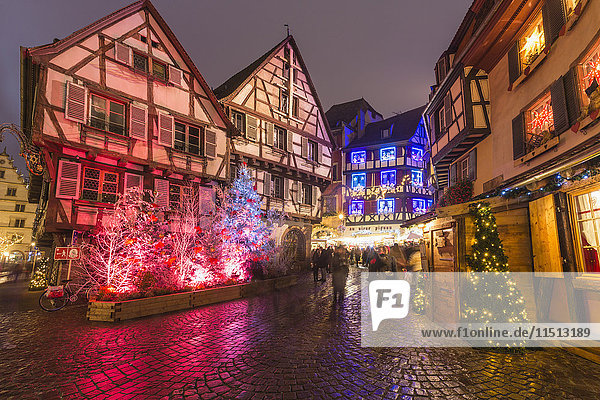 Typical houses enriched by Christmas ornaments and lights at dusk  Colmar  Haut-Rhin department  Alsace  France  Europe