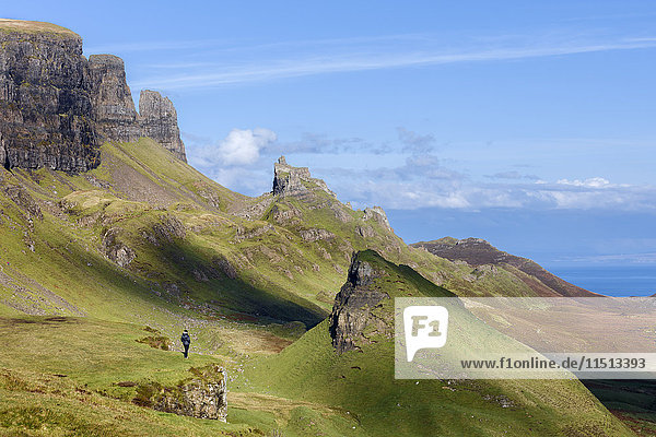 Looking out over the Quirang on the Trotternish ridge and beyond to the Isle of Harris in the Scottish Highlands  Isle of Skye  Inner Hebrides  Scotland  United Kingdom  Europe