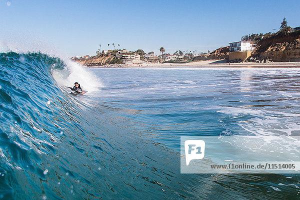 Man surfing in sea  Encinitas  California  USA