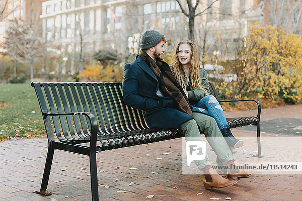 Young couple resting on park bench  Boston  Massachusetts  USA