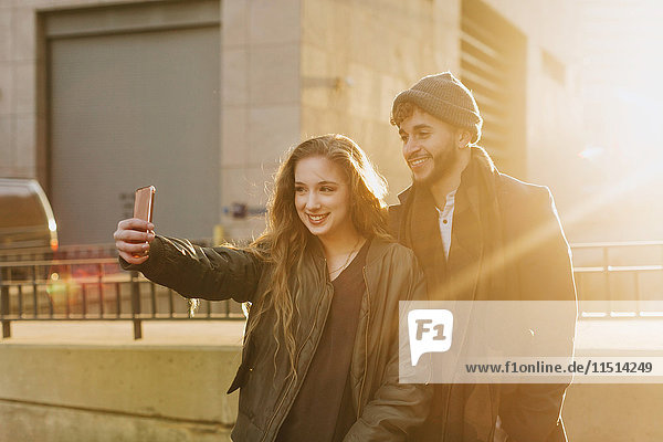 Young couple taking selfie in city  Boston  Massachusetts  USA