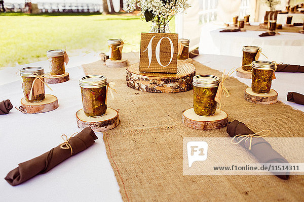 Wedding table with rustic place settings  outdoors