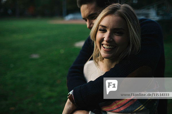 Young couple outdoors  embracing  laughing