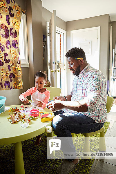 Father and daughter enjoying handicraft activity