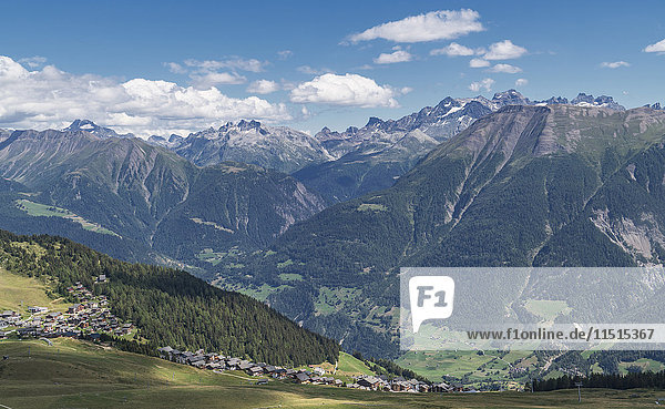 Village in green valley near mountains