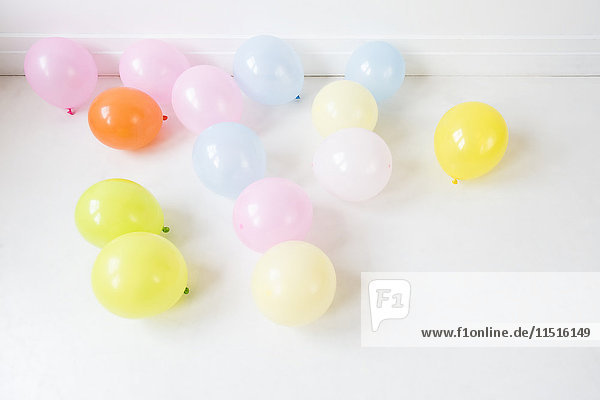 Multicolor balloons on white floor