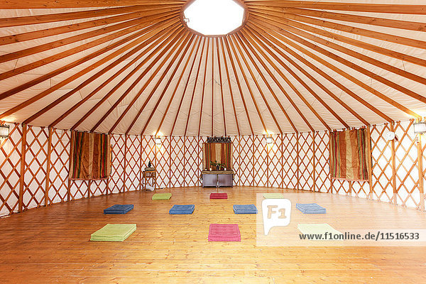 Exercise mats in empty yurt