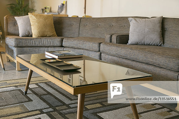 Coffee table with glass and sectional sofa
