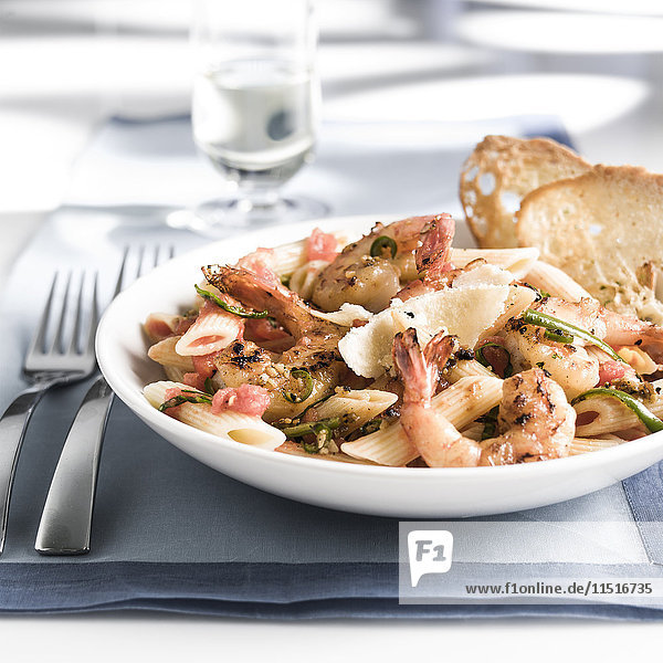 Plate of shrimp and pasta with bread