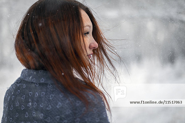 Hair of Caucasian woman blowing in wind in winter