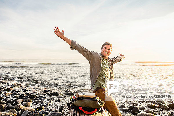 Portrait of happy man on beach in Juan de Fuca Provincial Park  Vancouver Island  British Columbia  Canada