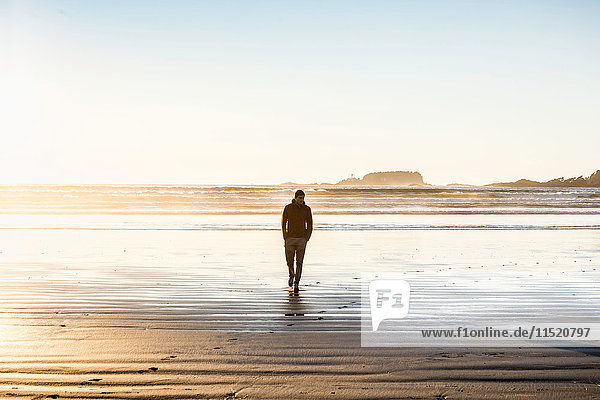 Man strolling on Long Beach  Pacific Rim National Park  Vancouver Island  British Columbia  Canada