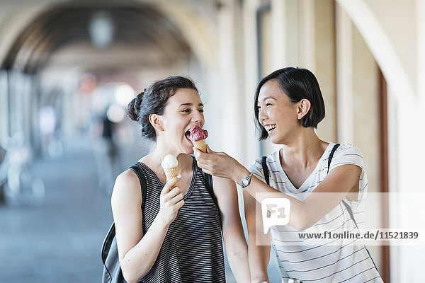 Two young women with ice cream cones