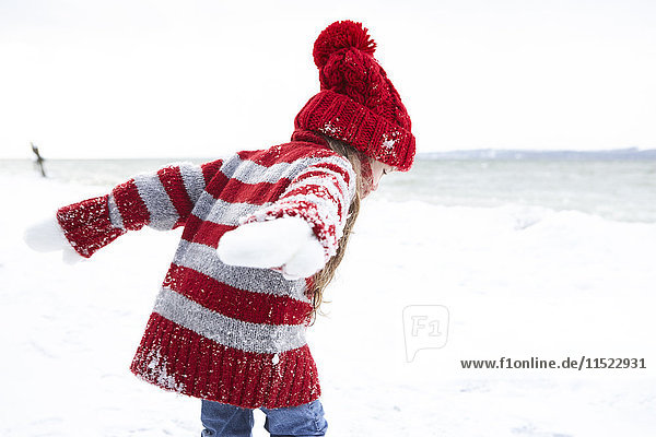 Little girl having fun in winter