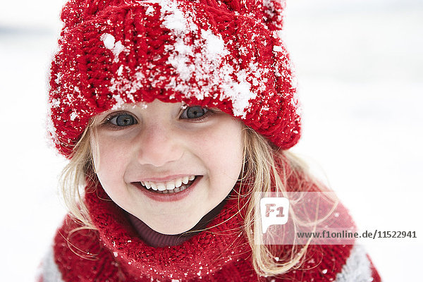 Little girl having fun in winter,  portrait