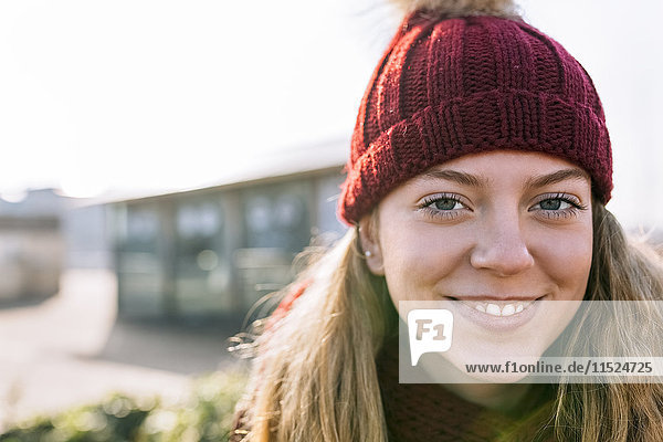 Portrait of smiling teenage girl wearing woolly hat