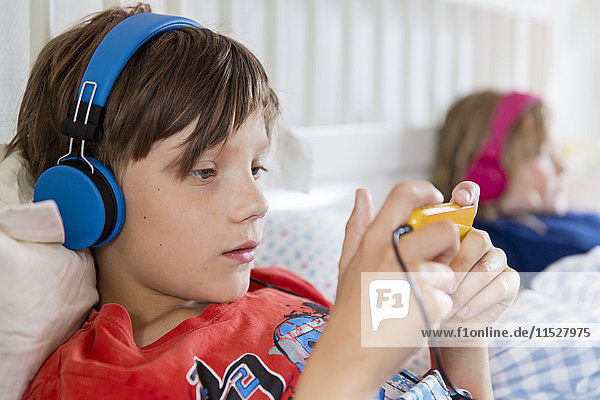 Boy in bed using cell phone