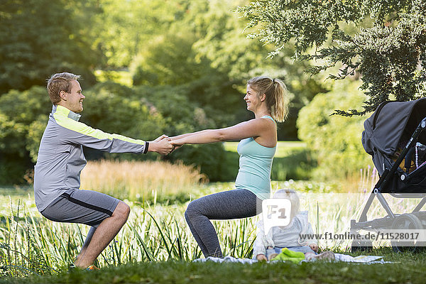 Young couple exercising in park