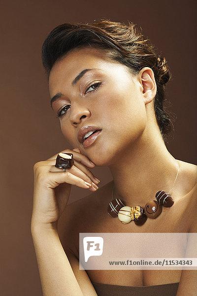 Portrait of Woman With Chocolate Jewelry