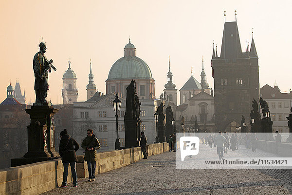 Czechia  Prague  Old town  Charles Bridge and Old Town Bridge Tower at sunset