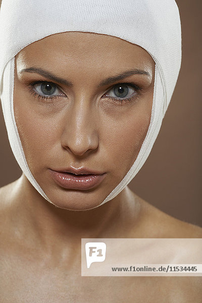 Portrait of Woman with Bandages On Head