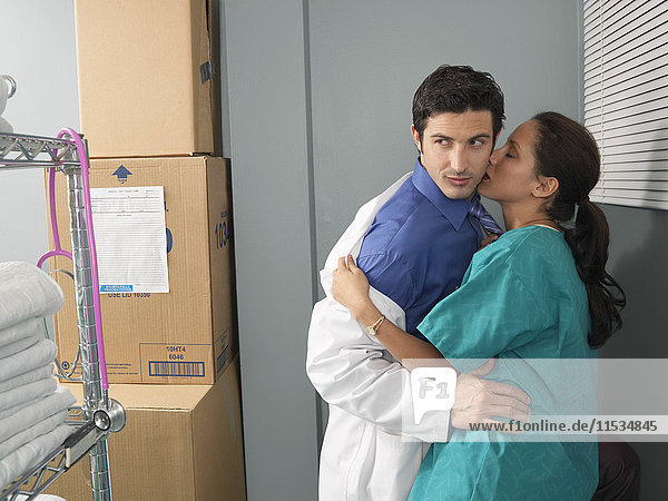 Doctor and Nurse Kissing in Supply Room
