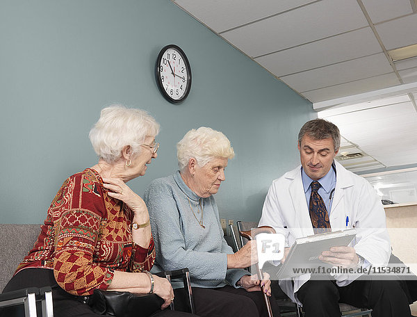 Doctor Speaking With Patients