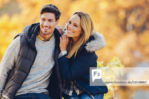 Happy couple enjoying autumn in a forest