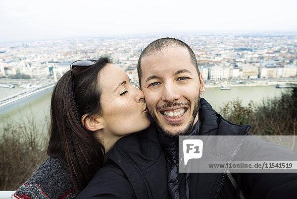 Hungary  Budapest  woman kissing man on Gellert Hill