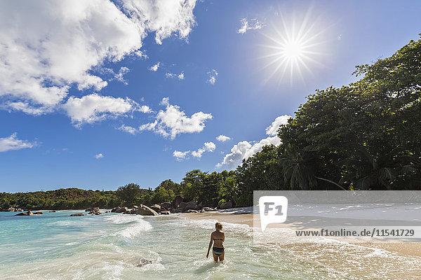 Seychelles  Praslin  Anse Lazio  beach  female tourist in water