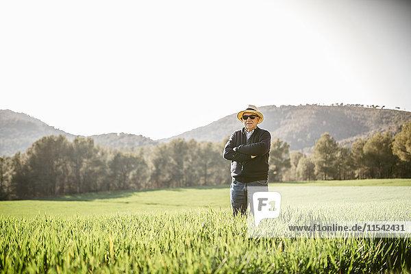 Spain  Tarragona  senior man standing in the field
