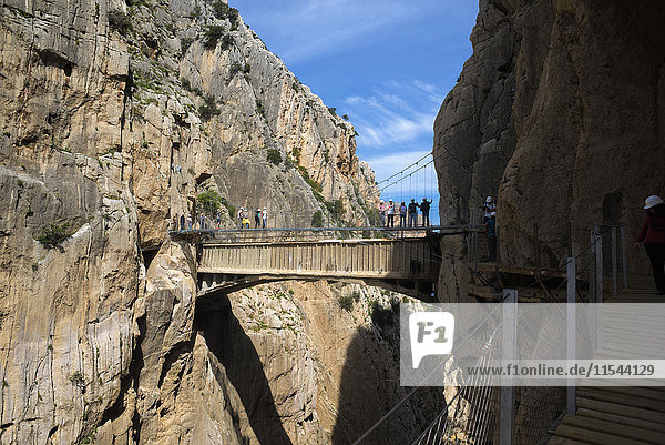 Spain  Ardales  The King's Little Pathway  tourists standing on skyway looking at view