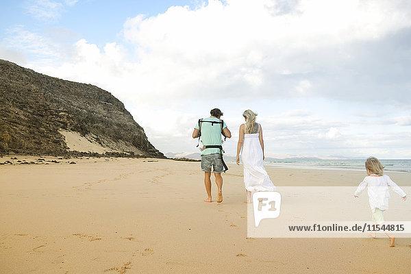 Spain  Fuerteventura  Jandia  family walking on beach