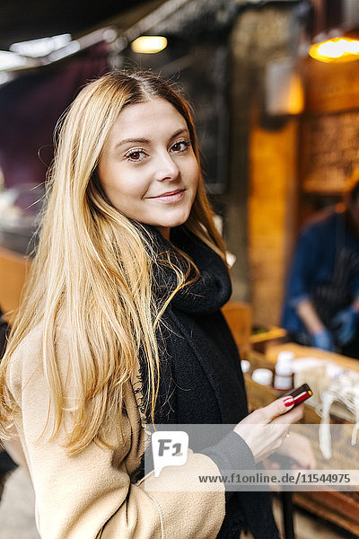 UK  London  Young woman using mobile phone
