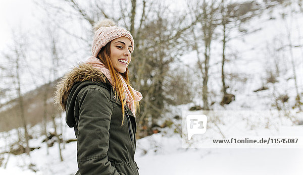 Spain  Asturias  happy young woman in the snowy mountains